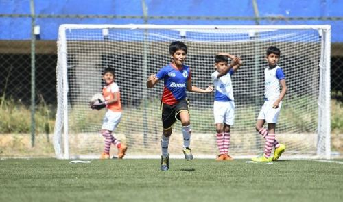 Action from the Boost-BFC Inter-School Soccer Shield