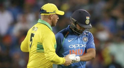 Opponent Skipper Aaron Finch consoles Rohit Sharma after his wicket