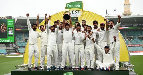 India celebrate their historic win against Australia in Australia