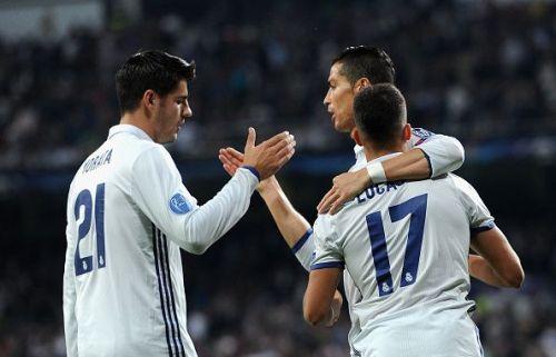 Alvaro Morata celebrates with his former teammates Cristiano Ronaldo and Lucas Vasquez