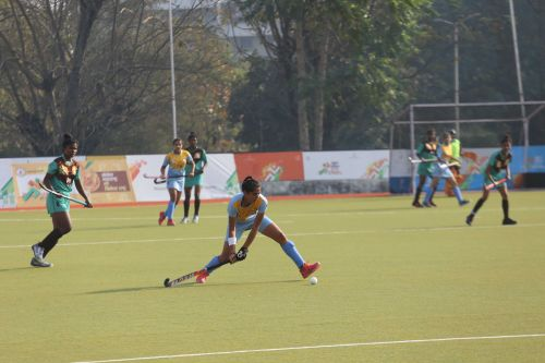 Haryana (in blue) in action against Jharkhand (in green) in the Girls' U-21 Hockey Final