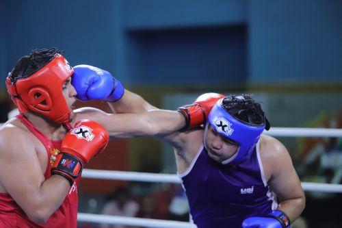 Boys' U-21 Super heavy (91+kg) gold medallist Harshpreet Saharwat (Blue) from UP in action