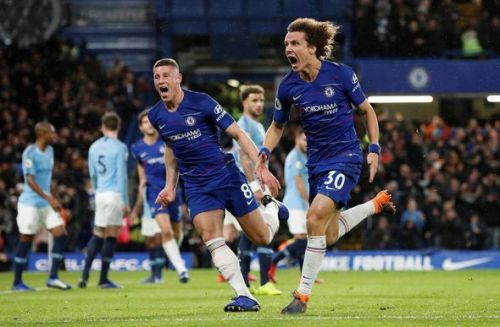 David Luiz celebrates after a second against Manchester City