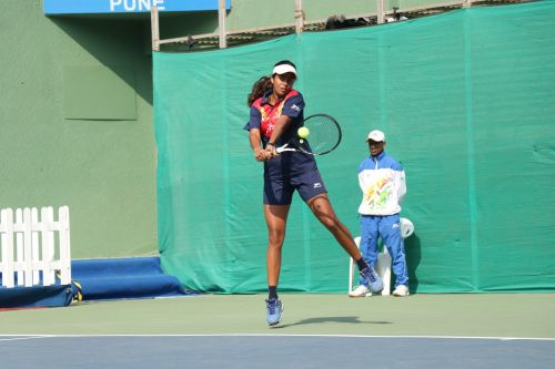 U-17 Girls tennis singles and double gold medalist Prerna Vichare (Maharashtra) in action at Khelo India Youth Games