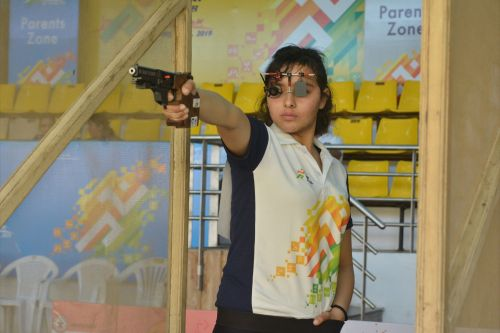 Gold medalist Devanshi Rana (Delhi) in action during girls U-21 25m pistol competition at Khelo India Youth Games