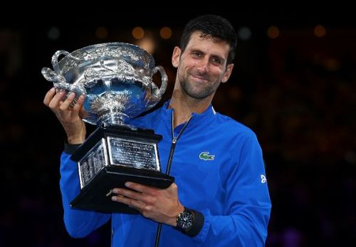Novak Djokovic lifts the Norman Brookes Trophy for a record 7th time
