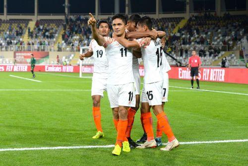 Chhetri celebrates with teammates after scoring