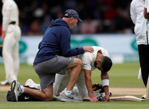 Virat Kohli receiving treatment on the field.
