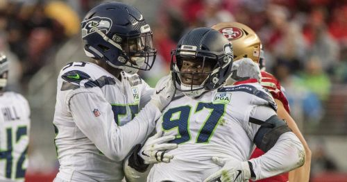 Poona Ford (right) in action for the Seattle Seahawks [Image: Seattle Times]