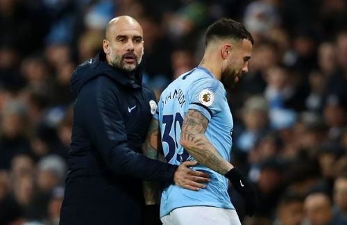 Pep Guardiola and Nicolás Otamendi