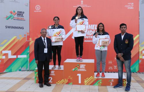 Gujarat's Maana Patel (in middle) with her 50m backstroke gold medal