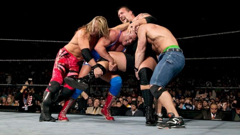Chris Jericho, Kurt Angle, and John Cena all trying to eliminate the Big Show during the 2004 Royal Rumble
