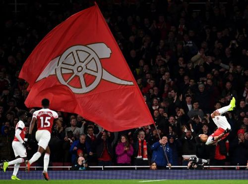 Arsenal celebratea goal against Fulham during their start of the year EPL game.
