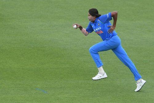 Jhulan Goswami runs in to bowl.