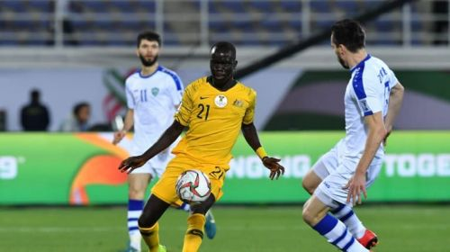 The Uzbekistan defenders didn't give Awer Mabil any free space to breathe