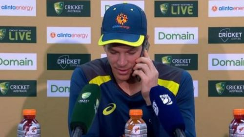 Image result for tim paine picks up a phone call at press conference