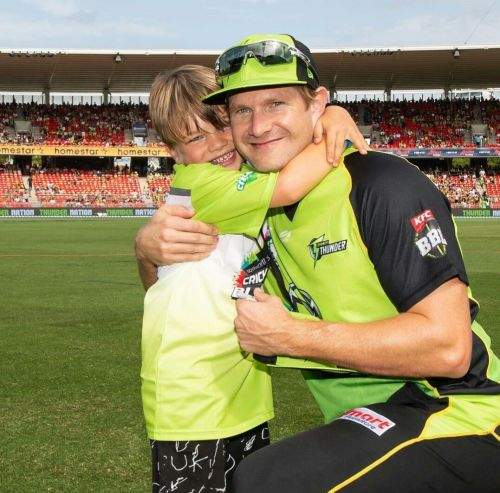 Shane Watson and his son Will during Sydney Thunder's match on Sunday