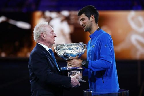 Rod Laver and Novak Djokovic share a moment during an event at the Australian Open 2019 on Monday