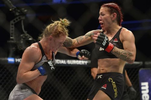 Holly Holm and Cris Cyborg in action during their UFC 219 main event display!