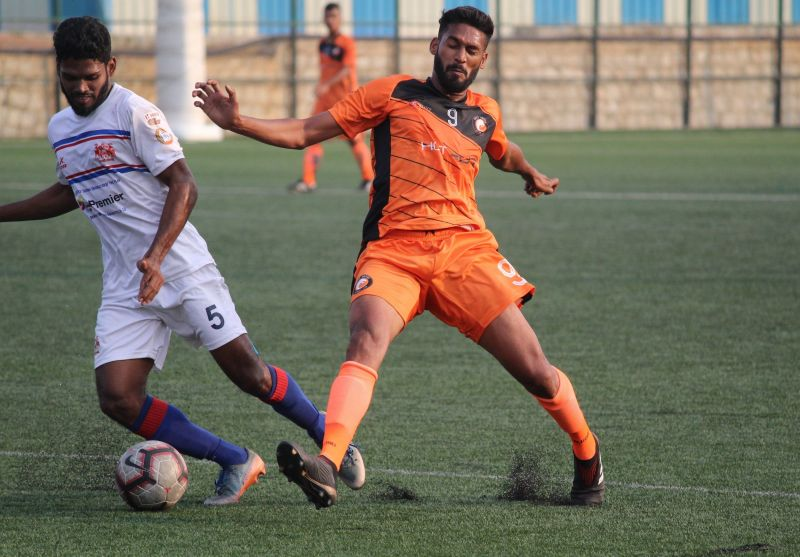 Cletus Paul of South United FC battles for the ball