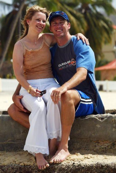 Glenn McGrath of Australia with wife Jane on the beach