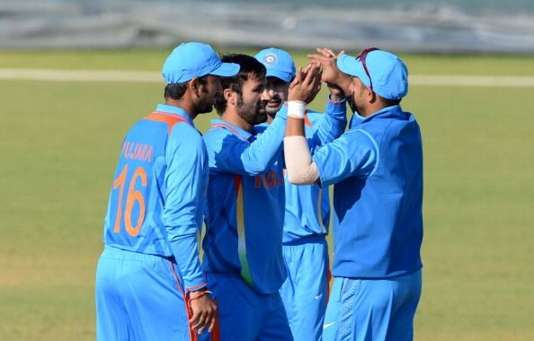 Parvez Rasool is being congratulated by his teammates