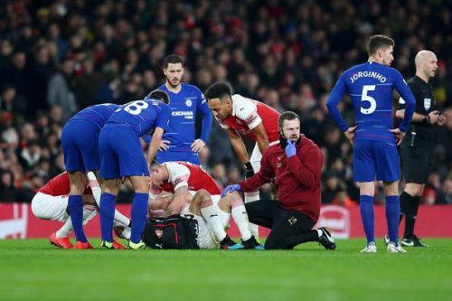 Bellerin being consoled by teammates and rivals alike as the Spaniard cried uncontrollably on the turf