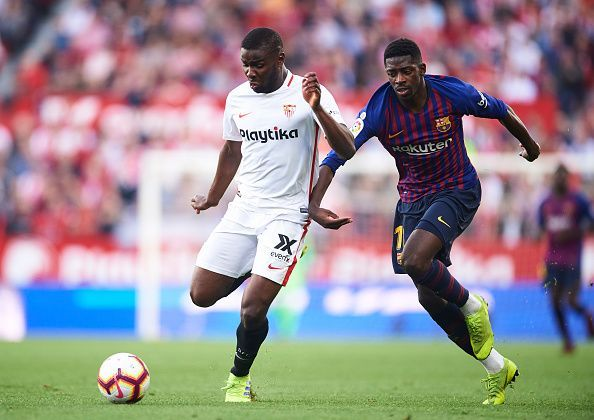 Ibrahim Amadou and Ousmane Dembele in action