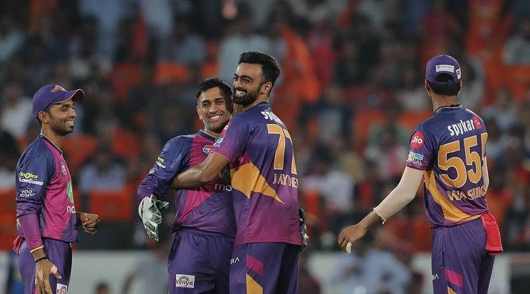 Jaydev Unadkat celebrating with his team-mates after claiming his hat-trick
