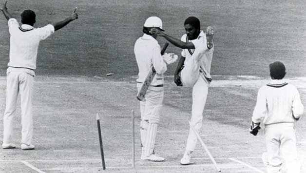 The infamous photograph of Michael Holding kicking the stumps