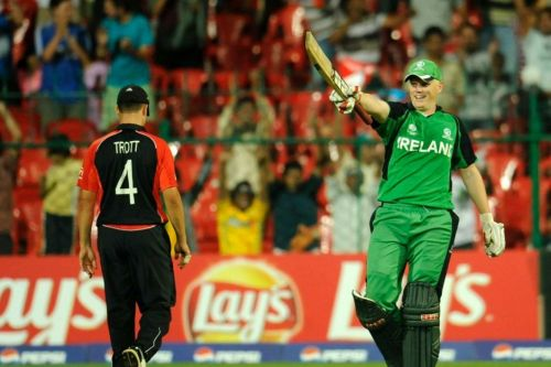 Kevin O'Brien celebrates his century against England.