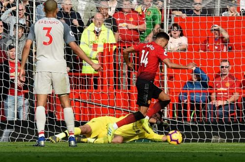 Alisson Becker made a big save to deny Jesse Lingard in the first half