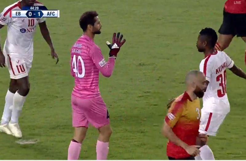 East Bengal goalkeeper Rakshit Dagar collects the ball but Aizawl