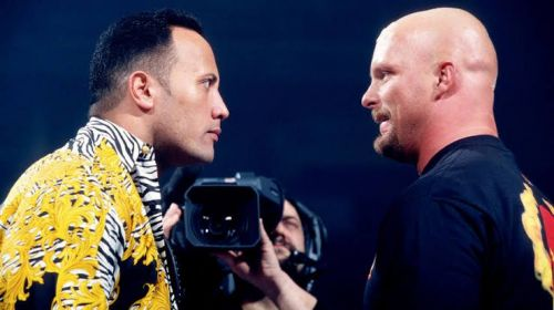 The Rock and Steve Austin having a staredown while promoting their match at WrestleMania