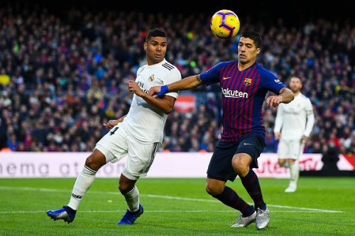Casemiro and Luis Suarez battle out for the ball