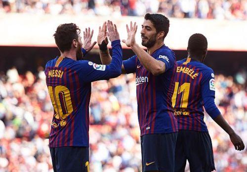Goal-scorers Lionel Messi and Luis Suarez celebrate