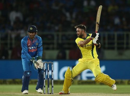 Glenn Maxwell batting as wicketkeeper MS Dhoni watches