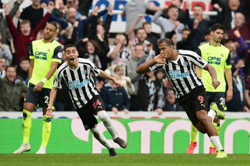 Miguel Almiron celebrates against Huddersfield Town As Newcastle move towards safety