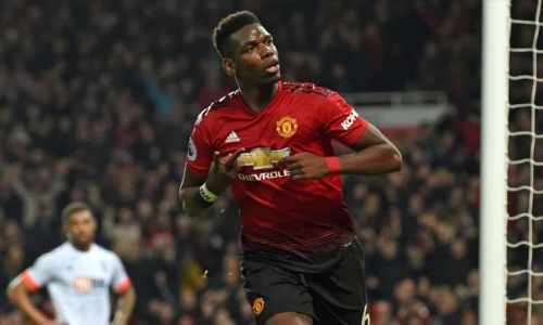 Paul Pogba celebrates after scoring one of his two goals against Bournemouth
