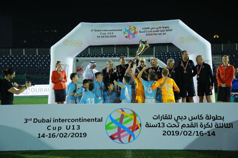 Celta de Vigo players celebrate as they receive the Dubai U13 Intercontinental Cup trophy from HE Saeed Hareb, Secretary General of Dubai Sports Council.