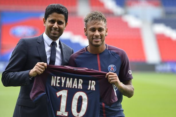 Neymar with Nasser Al Khelaifi upon signing for PSG