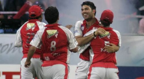 Yuvraj celebrates his hat-trick with teammates