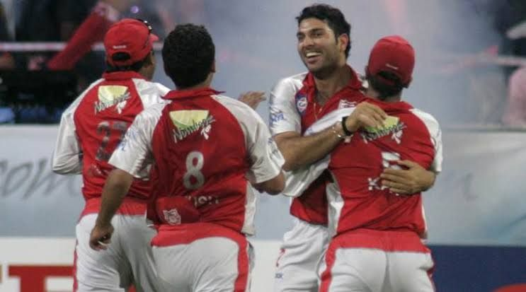 Yuvraj celebrates his hat-trick with teammates