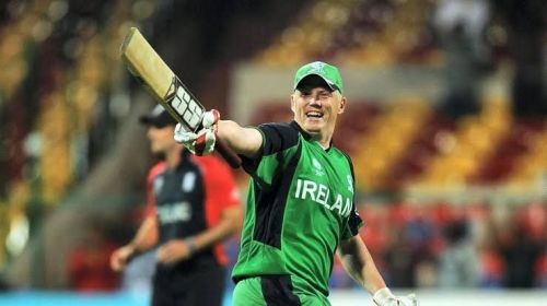 Kevin O'Brien celebrates his century against England