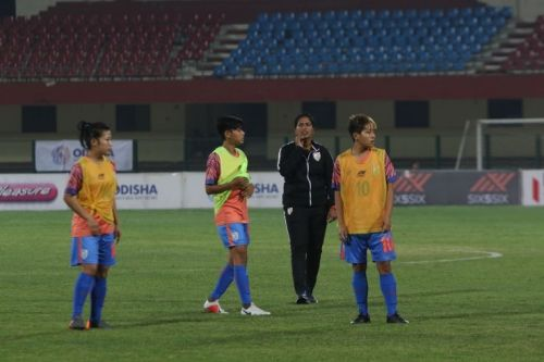 Coach Maymol Rocky (second from right) with players of the Indian Women's Football Team