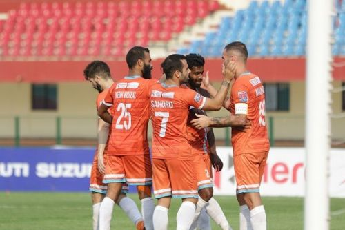Chennai City players celebrate Vijay's goal against Indian Arrows