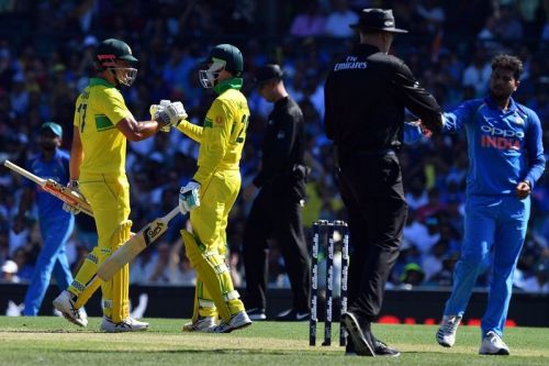 Khawaja and Handscomb join together after playing out a Kuldeep Yadav over