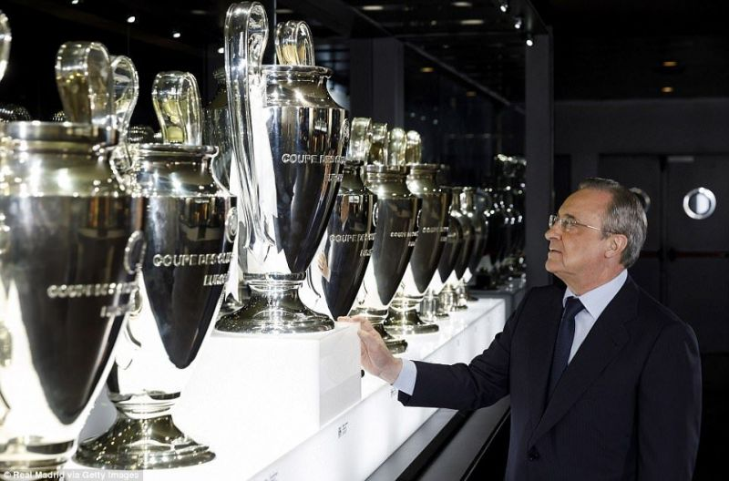 Real Madrid CF President Florentino Perez looks at the UEFA Champions League Trophy