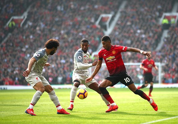 Rashford - who also picked up an injury in the first-half - pictured here, battling with Salah and Wijnaldum
