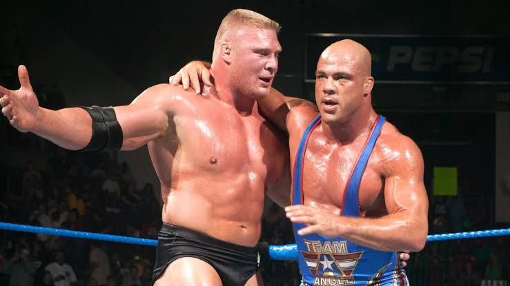 Lesnar and Angle embracing after their classic match!